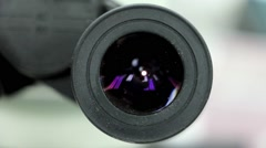 Look into the microscope with a gradual delaying Stock Footage