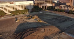 Aerial view of tractors digging a hole on a construction site in Dallas, Texas. Stock Footage