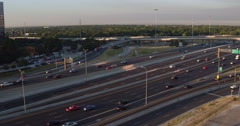 Ascending aerial footage of cars driving on the paved freeway Stock Footage