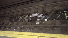Panning across trash on subway station tracks - dirty MTA interior in 4K NYC Stock Footage