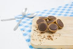 Group of chocolate candy isolated on wood. concept - stock photo