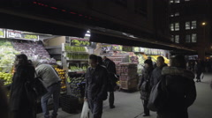 Fruit grocery store Upper West Side Manhattan, people walking street night 4K NY Stock Footage