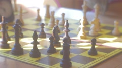 Kids' Hands Are Moving the Chess Pieces Board Close up Sun Rays Kids Are Stock Footage