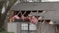 Tornado aftermath - damaged homes roof damage Stock Footage