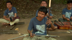 Blind band plays for money in Ta Phrong Cambodia Stock Footage
