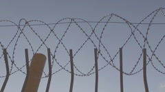 The iron fence and barbed wire Stock Footage