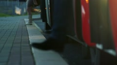 Stock Video Footage of Slowmotion people get off from bus - closeup legs