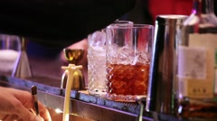 Barman making drinks in bar - stock footage