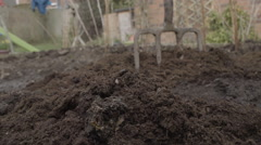 Damp soil ready for growing veg Stock Footage