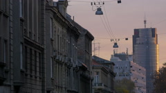 View of old buildings and Cibona tower at sunset, Zagreb Stock Footage