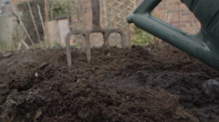 Garden Fork Digging A Veggie Patch With Compost In Spring Stock Footage