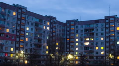 Time lapse of multistorey building with changing window lighting at night Stock Footage