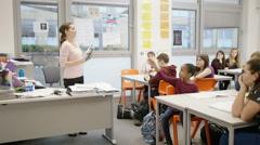 England December 2015 – British schoolchildren listening to teacher in classroom Stock Footage