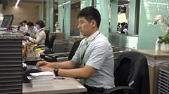 Korean Air ground personnel print boarding passes at Incheon airport, Seoul Stock Footage