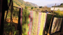 Handicraft fabric flowing in Cat Cat Village, Sapa. - stock footage