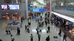 Duty free shopping area, airline passengers, Incheon airport, Seoul, South Korea - stock footage