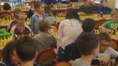 "Chess Club ""black Knight"" Kids at the Chess Tournament Are Playing People Are Stock Footage"