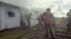 Firefighters get their water hoses ready - stock footage