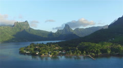 AERIAL: Beautiful exotic island with tropical forest and blue lagoon Stock Footage