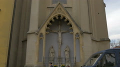 Statues of Crucified Jesus, Mary and Saint John at Saint Francis Church, Zagreb - stock footage