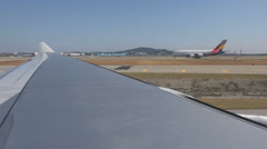Wing of a Korean Air flight taxiing to the runway at Incheon Airport in Seoul Stock Footage