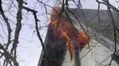 Raging fire burns in upper story window Stock Footage