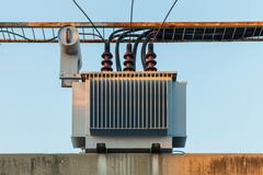 Electric transformer on pole and high-voltage lines Kuvituskuvat