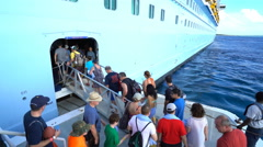 Passengers getting on cruise ship - Anthem of the Seas - stock footage