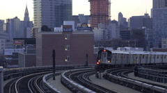 Queens bound 7 train at sunset. - stock footage