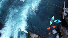 Aerial: whitewater kayakers conquering rapids in Patagonia - stock footage