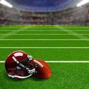 Football Stadium With Helmet and Ball and Copy Space Stock Photos
