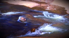 Medium Shot of Water running down Slide Rock Stock Footage