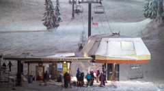 Stevens Pass Washington Skiers and Snowboarders Loading Hogsback Chairlift - stock footage