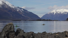Two Kayakers Paddling in Scenic Alaska 4K Stock Footage