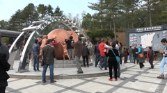 Tour groups take photos of monument in DMZ, North South Korea conflict - stock footage