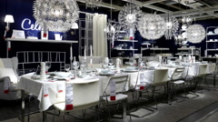 Motion of display dining room furniture inside Ikea store Stock Footage