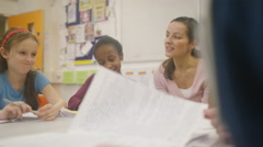 4K Teacher working with young pupils in school lesson - stock footage