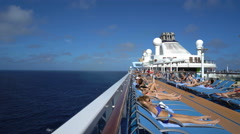 Cruise ship at sea. Ocean and pool deck view - Anthem of the seas - stock footage