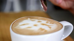 Eating Cappuccino Foam with Spoon in Coffee Shop Stock Footage