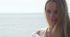 Close up portrait of beautiful young blond woman - stock footage
