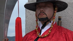 Face expression traditional uniform soldier guard palace Seoul South Korea Stock Footage