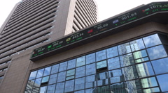 Electronic ticker board displaying currency exchange rates, Seoul, South Korea Stock Footage