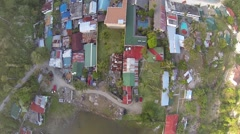 AERIAL OVERHEAD SHOT OF LOCAL HOUSES AND CLEAR BLUE OCEAN Stock Footage