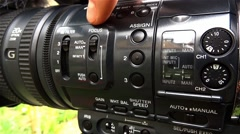 Cameraman press different buttons on the your camcorder to change the working Stock Footage