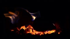 Playful flames that engulfed a wood put in the stove to warm the cold air in Stock Footage