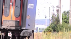 Passenger train departs from station Stock Footage