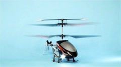 Toy helicopter which revs up the engines to take off but fails Stock Footage