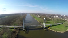 Aerial flying over small white suspension bridge for people and cycles 4k Stock Footage