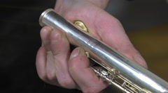 a craftsman recovering blows of a flute - stock footage