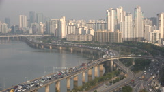 Busy morning rush hour traffic on elevated highway in Seoul, South Korea Stock Footage